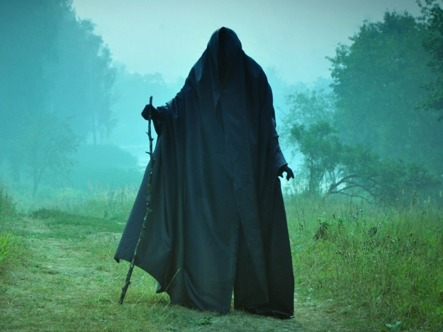 man in black cape